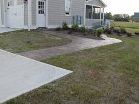 Home with level sidewalk and driveway.